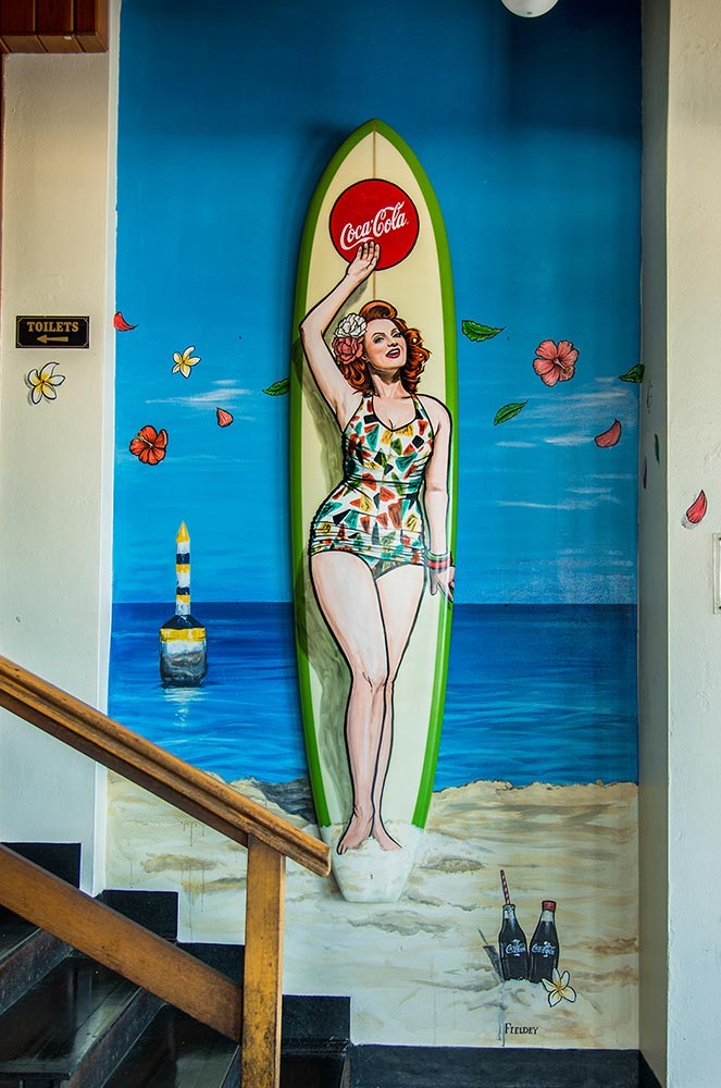 Custom pin up gidget girl surfboard and street art mural