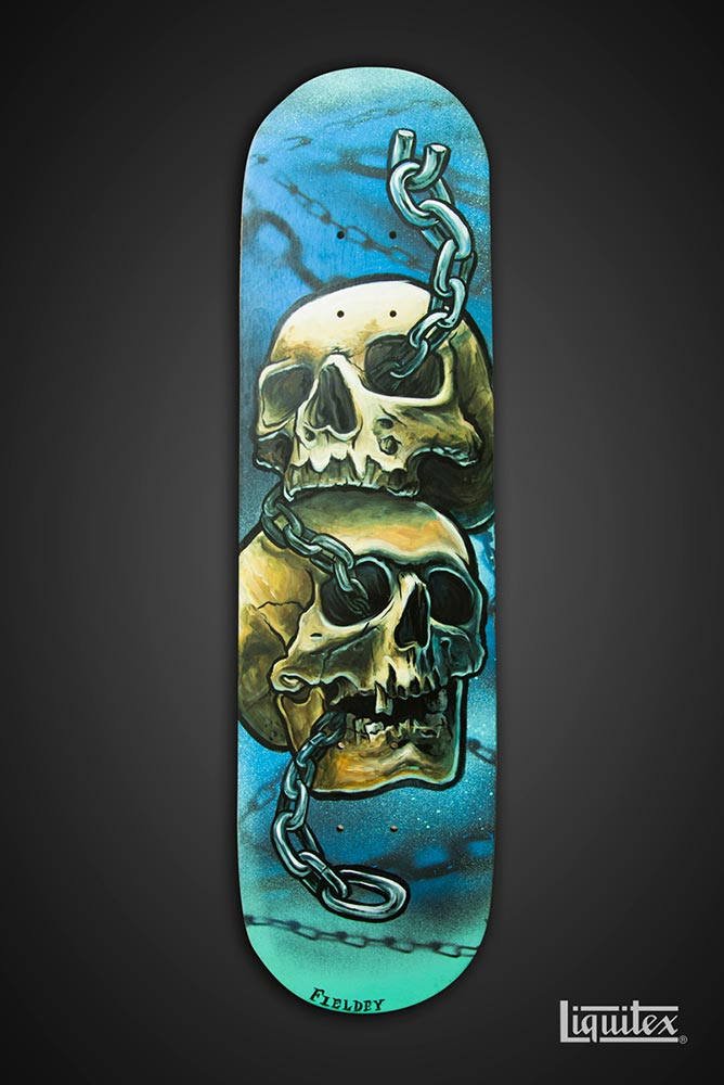 Skulls and chains tattoo-style skate art