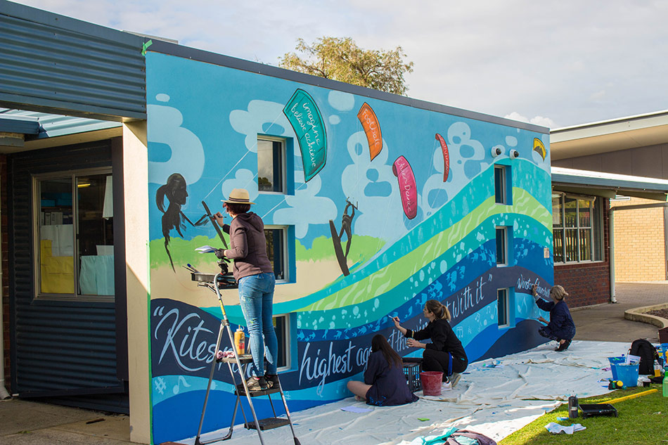 Fieldey facilitating a student led mural at Safety Bay Senior High school
