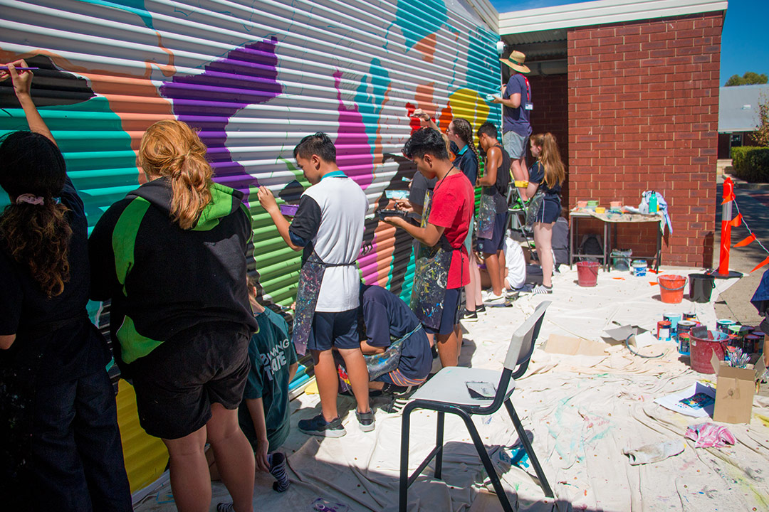 Students painting a mural with Fieldey at Safety Bay Senior High